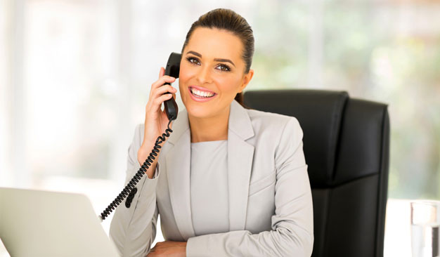 legal answering service agent sitting at desk